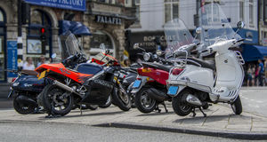 Amsterdam, Netherlands - July 19th, 2014: A row of mopeds / scooters parked up in Amsterdam. Amsterdam, Netherlands - July 19th, 2014: A row of mopeds / Stock Photography