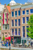 Amsterdam, Netherlands - July 10, 2015: Traditional Dutch city blocks with charming red brick buildings Stock Image