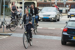 Women driving bicycles Stock Photography
