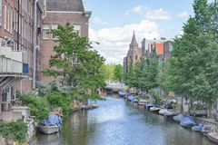 AMSTERDAM, NETHERLANDS - JUN 10, 2010: Canals of Amsterdam. Amsterdam is the capital and most populous city of the Netherlands. AMSTERDAM, NETHERLANDS - JUN 10 Royalty Free Stock Photo