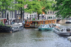 AMSTERDAM, NETHERLANDS - JUN 10, 2010: Canals of Amsterdam. Amsterdam is the capital and most populous city of the Netherlands. Royalty Free Stock Photos