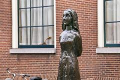 Free AMSTERDAM, NETHERLANDS - JUNE 25, 2017: Anne Frank Statue On Westerkerk Plaza Near The Anne Frank House. Stock Photos - 126494913