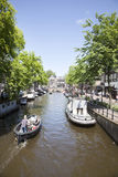 AMSTERDAM, NETHERLANDS, JUNE 8 2014: boats in Spiegelgracht in A Royalty Free Stock Images