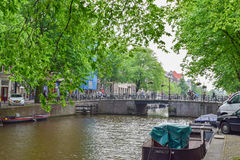 AMSTERDAM, NETHERLANDS - JUNE 6, 2016: Bridge over one of the ca Stock Photography