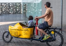 Bakfiets or front-trunk bike on the move in Amsterdam Netherlands