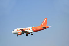 Amsterdam, The Netherlands - June 12 2015: G-EZIW easyJet Airbus. A319-111 takes off at Amsterdam Airport Schiphol Polderbaan runway. EasyJet is a British low Royalty Free Stock Photos