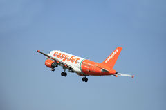 Amsterdam, The Netherlands - June 12 2015: G-EZIW easyJet Airbus. A319-111 takes off at Amsterdam Airport Schiphol Polderbaan runway. EasyJet is a British low Royalty Free Stock Images