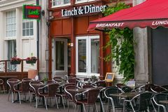 AMSTERDAM, NETHERLANDS - JUNE 25, 2017: Outside view of the Lunch and Dinner cafe in the historical center. Outside view of the Lunch and Dinner cafe in the royalty free stock photos