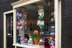 AMSTERDAM, NETHERLANDS - JUNE 25, 2017: Storefront of souvenir shop with different knitted hats. Storefront of souvenir shop with different knitted hats in the royalty free stock photography