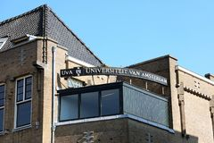 AMSTERDAM, NETHERLANDS - JUNE 6, 2018: UVA Universiteit van Amsterdam university signboard, Netherlands royalty free stock photography