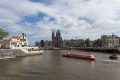 Amsterdam. NETHERLANDS - June 13, 2015: View at  in the Netherlands.  is home to more than one hundred kilometers of canals Stock Photo