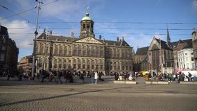 Amsterdam, Netherlands - 14.10.2019: A lot of tourists in The Royal Palace of Amsterdam located on the Dam Square in city centre.