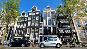 Amsterdam, Netherlands. 25.04.2019. Magnificent architecture of Amsterdam houses. The houses are tilted in different stock footage