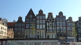 Amsterdam, Netherlands. 25.04.2019. Magnificent architecture of Amsterdam houses. The houses are tilted in different stock video