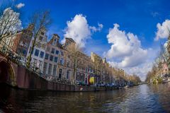 AMSTERDAM, NETHERLANDS, MARCH, 10 2018: Beautiful outdoor view Amsterdam canals with bridge and typical dutch houses Royalty Free Stock Photos
