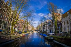 AMSTERDAM, NETHERLANDS, MARCH, 10 2018: Outdoor view of houses and Boats on Amsterdam Canal Royalty Free Stock Image
