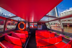 AMSTERDAM, NETHERLANDS, MARCH, 10 2018: Indoor view of red excursion boat or cruise ship on Amsterdam water canal in the. Center of Amsterdam, Amstel river Stock Photography