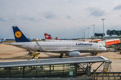 Lufthansa airplane on boarding position at airport royalty free stock images