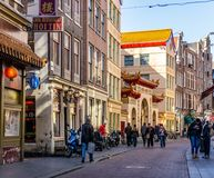 AMSTERDAM, NETHERLANDS - March 20, 2018 : narrow streets of chinatown in Amsterdam at sunny spring day. stock images
