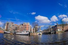 AMSTERDAM, NETHERLANDS, MARCH, 10 2018: Outdoor view of skinny Bridge Dutch: Magere Brug over the Amstel river in. Amsterdam, Netherlands, North Holland royalty free stock photo