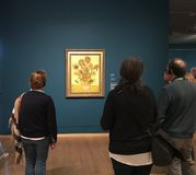 AMSTERDAM, NETHERLANDS - MARCH 19, 2019: Visitors looks at the paintings by Vincent van Gogh in Museum Van Gogh in Amsterdam,. AMSTERDAM, NETHERLANDS - MARCH 19 stock images