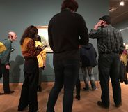 AMSTERDAM, NETHERLANDS - MARCH 19, 2019: Visitors looks at the paintings by Vincent van Gogh in Museum Van Gogh in Amsterdam,. AMSTERDAM, NETHERLANDS - MARCH 19 royalty free stock photos