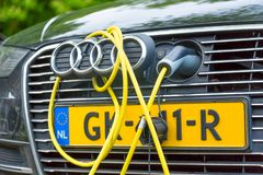 Amsterdam, the Netherlands - May, 2018: Audi TFSI e-tron petrol-electric hybrid car charging in the street of Amsterdam, Noth Holl. And royalty free stock photos