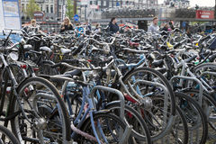 Amsterdam. NETHERLANDS - MAY, 12, 2017: Bicycle parking next to the central railway station Royalty Free Stock Photos