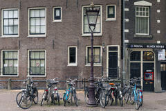 Amsterdam. NETHERLANDS - MAY, 16, 2017: Bicycles next to a lamppost Royalty Free Stock Photos