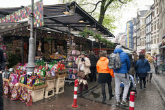 Amsterdam. NETHERLANDS - MAY, 13, 2017: The Bloemenmarkt is the world`s only floating flower market. Founded in 1862, it is sited in , on Singel between Stock Photos