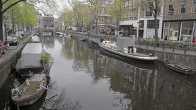 Amsterdam. NETHERLANDS - MAY 15, 2017: The city on a cloudy spring day stock footage