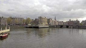 Amsterdam. NETHERLANDS - MAY 15, 2017: The city on a cloudy spring day stock video