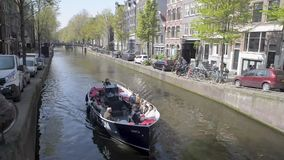 Amsterdam. NETHERLANDS - MAY 15, 2017: The city on a cloudy spring day stock video footage