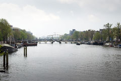Amsterdam. NETHERLANDS - MAY, 13, 2017: The city on a cloudy spring day Royalty Free Stock Photography