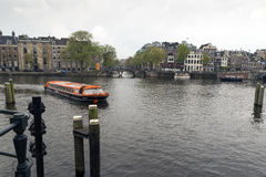 Amsterdam. NETHERLANDS - MAY 13, 2017: The city on a cloudy spring day Royalty Free Stock Photos