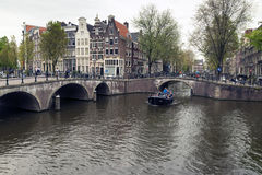 Amsterdam. NETHERLANDS - MAY 15, 2017: The city on a cloudy spring day Royalty Free Stock Photo