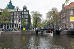 Amsterdam. NETHERLANDS - MAY 15, 2017: The city on a cloudy spring day Royalty Free Stock Image