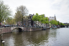Amsterdam. NETHERLANDS - MAY 15, 2017: The city on a cloudy spring day Royalty Free Stock Photos