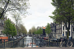 Amsterdam. NETHERLANDS - MAY 15, 2017: The city on a cloudy spring day Royalty Free Stock Photography