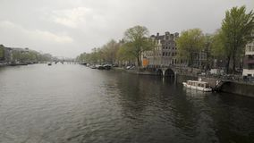 Amsterdam. NETHERLANDS - MAY, 13, 2017: The city on a cloudy spring day stock video