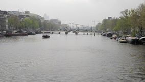 Amsterdam. NETHERLANDS - MAY, 13, 2017: The city on a cloudy spring day stock video footage