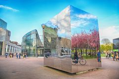 Cityscape with mirror cube near Van Gogh Museum, Amsterdam, Netherlands. stock images