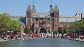 I Am Amsterdam. Amsterdam, Netherlands - May 15, 2018: Crowd of Tourists at I Am Amsterdam Sign Between Pond Water and Rijksmuseum in Amsterdam, Netherlands stock footage