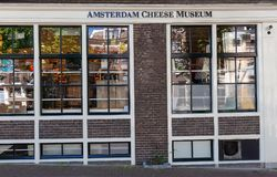 Facade of Amsterdam`s Cheese Museum, Amsterdam, Netherlands. AMSTERDAM, NETHERLANDS - MAY 21, 2018: Facade of Amsterdam`s Cheese Museum, Amsterdam Netherlands stock images