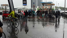 AMSTERDAM, NETHERLANDS 04 May 2017 In heavy rain, people on bikes leave the ferry connecting two shores. stock video footage