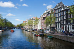 Amsterdam, Netherlands - May 7, 2015: Passenger boats on canal tour in the city of Amsterdam Stock Photos