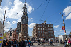 Amsterdam, Netherlands - May 8, 2015: People at The Munttoren (Mint Tower) Muntplein square in Amsterdam Stock Images