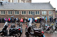 Amsterdam, Netherlands - May 16, 2015: People queuing at the Anne Frank house. And holocaust museum in Amsterdam, Netherlands, on May 16, 2015. Anne Frank house Royalty Free Stock Images