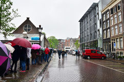 Amsterdam, Netherlands - May 16, 2015: People queuing at the Anne Frank house. And holocaust museum in Amsterdam, Netherlands, on May 16, 2015. Anne Frank house Stock Image