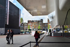 Amsterdam, Netherlands - May 6, 2015: People visit famous Stedelijk Museum in Amsterdam Royalty Free Stock Photo